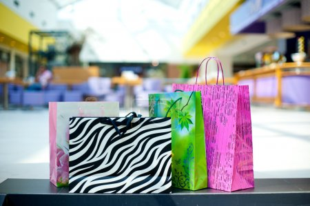 Photo for Few different shopping bags on the floor - Royalty Free Image