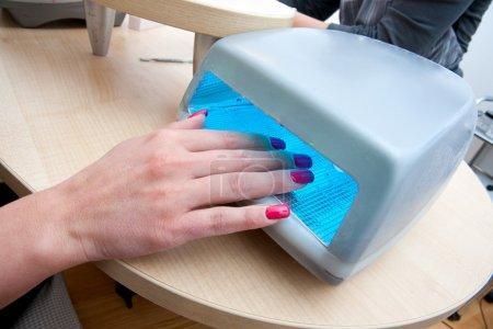 Photo pour Nail art polonais acrylique gel uv sèche - image libre de droit