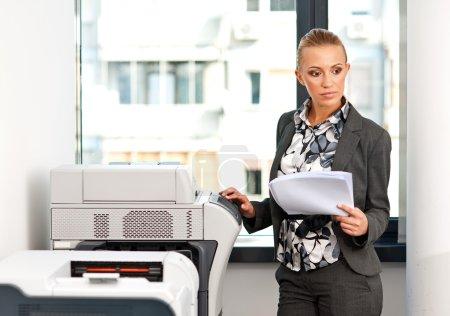 woman working on copy machine