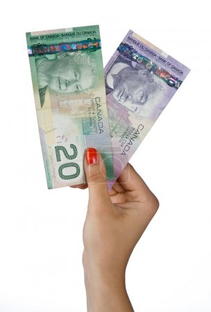 woman hand with canadian dollar bills