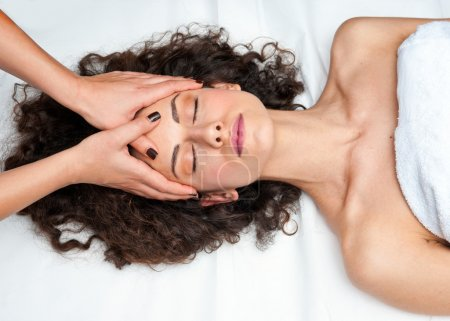 woman having cyropractick neck adjustment