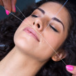 Attractive woman in beauty salon on facial hair re...