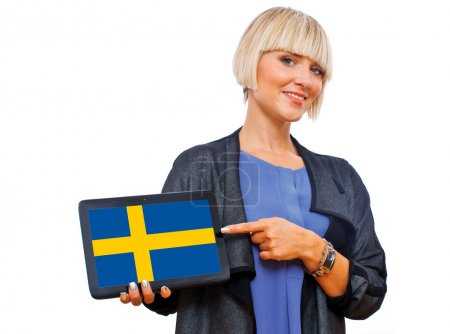 Attractive blond woman holding tablet with sweden flag