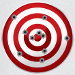 Red and white shooting range target shot full of b...