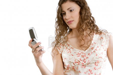 Young woman holding a cell phone in her hand