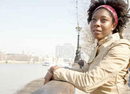 african american woman sightseeing in London's river Thames