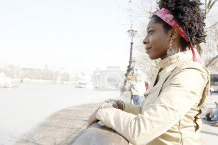 african american woman at London's river Thames