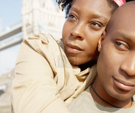 Close up portrait of an attractive african american couple visiting the Tower of London