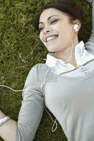 young woman listening to music on her headphones