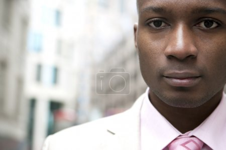 Photo for Close up portrait of a young businessman in the city. - Royalty Free Image