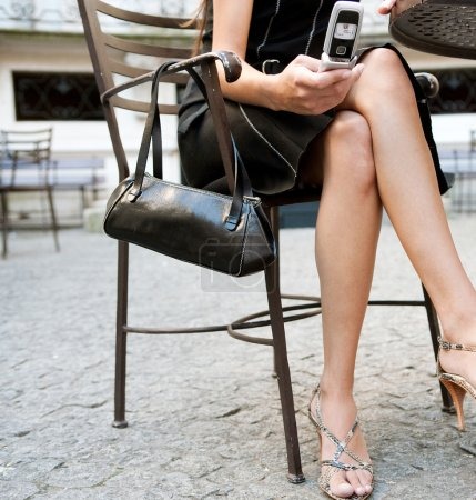 Low section of a sexy businesswoman sitting in a luxurious coffee shop terrace