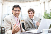 Two businessmen laughing while having a meeting