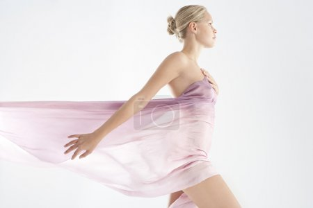 Beautiful young woman wearing a pink sarong around her body