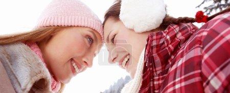 Two joyful women friends