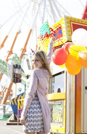 Teenage girl in an amusement park
