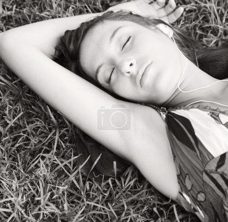 Woman laying on textured green grass
