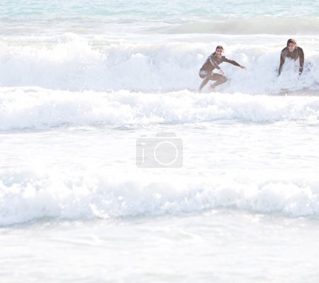Surfers starting to ride
