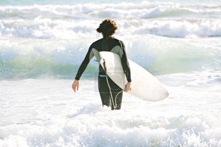 Young surfer man