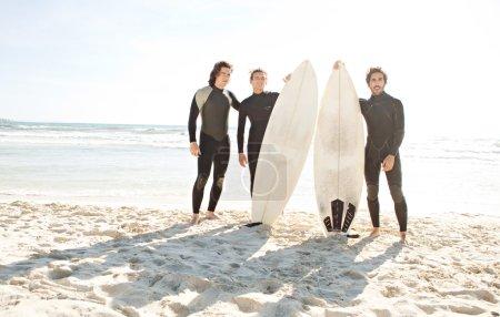 Surfers men standing