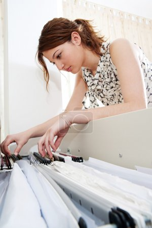 Businesswoman flicking clients files