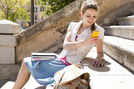 Girl using her smartphone