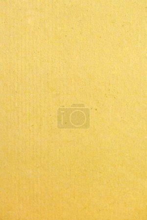 Photo pour Pièce de fond jaune de main fabriquer du papier avec une texture naturelle. - image libre de droit