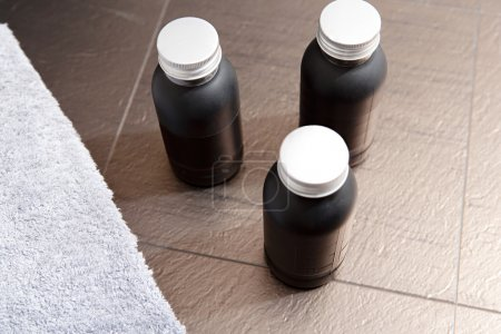 Masculine home bathroom with male lotions