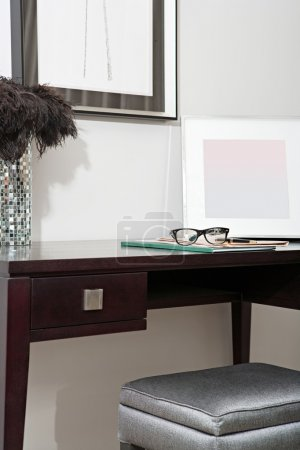 Corner with photo frames and a writing desk