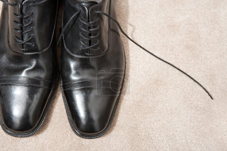 Pair of black leather businessman shoes