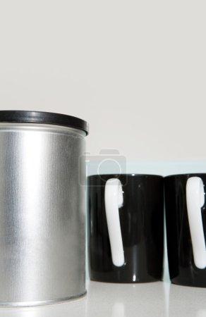 Two black and white tea mugs