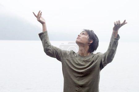 Man doing tai-chi training during a rainy autumn day