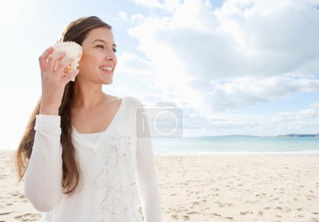 Woman holding a sea shell