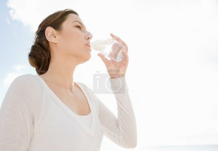 Woman holding glass of pure mineral water