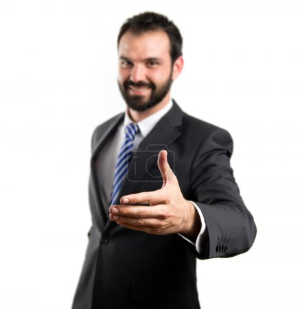 Photo pour Homme d'affaires faisant un marché sur fond blanc isolé - image libre de droit
