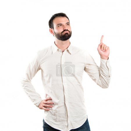 Photo for Young man pointing up over white background - Royalty Free Image