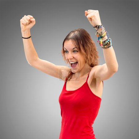 Young woman winner on white background