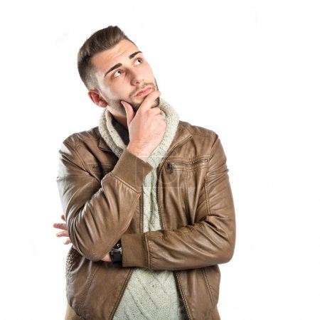 Young man thinking over white background