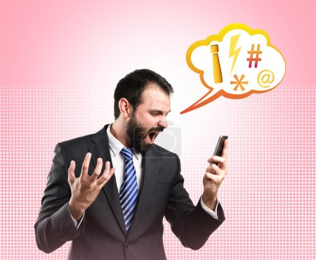 Photo for Young businessmen shouting to mobile over pink background. - Royalty Free Image