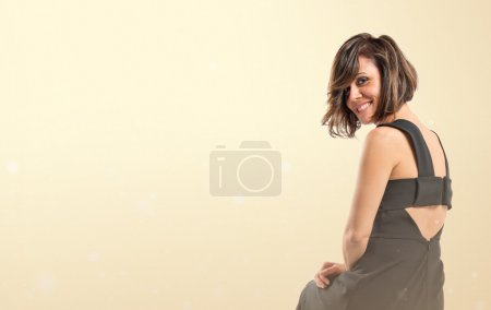 Photo for Pretty brunette woman isolated over ocher background - Royalty Free Image