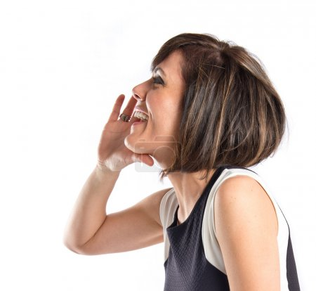 Adult girl shouting over isolated white background