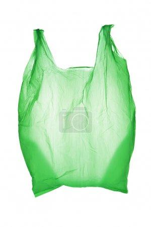 Photo pour Sac en plastique vert isolé sur fond blanc - image libre de droit