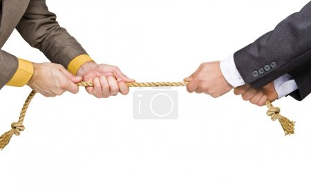Photo for Tug of war between businessmen - Royalty Free Image