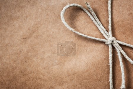 Photo for Brown paper gift package background with twine and copy space - Royalty Free Image