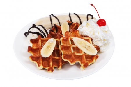 Belgian waffles with whipped cream and scoop of ice cream.