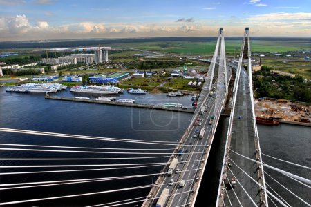 Cable stayed bridge under construction, and a berth for ships.