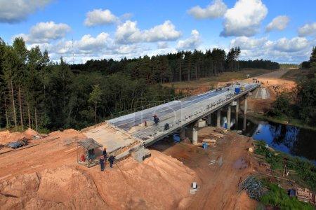 Construction of a concrete bridge across the river stream