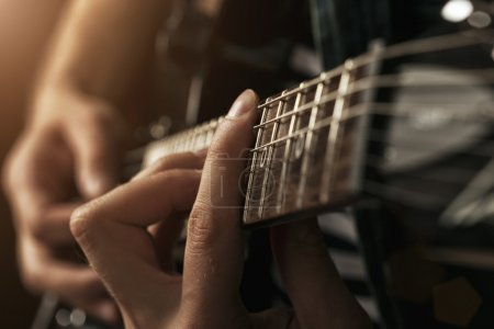 Photo for Guitarist plays - Royalty Free Image
