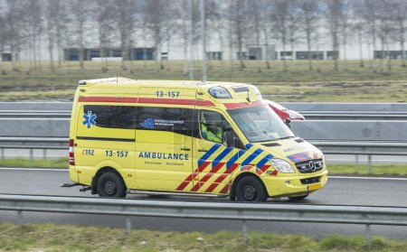 Mercedes Ambulance driving down the road