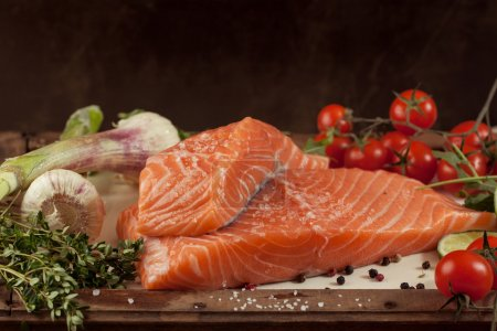 Photo for Salted fresh salmon fish on vintage board with vegetables and spice - Royalty Free Image