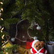 Christmas decoration with antique teddy bear in sa...